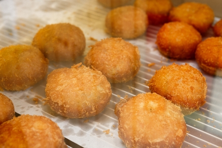 Croquette on top of baking paper Stock Photo