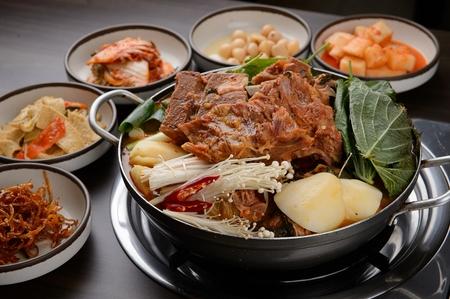 Korean cuisine Gamjatang, spicy pork back-bone stew with potato, mushroom and sesame leaf in pot