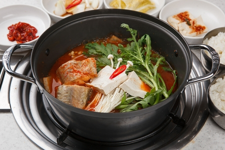 spicy codfish soup with vegetables like corwn daisy, tofu and mushroom