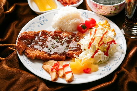 Donkatsu, pork cutlet with salad, fried potato and rice