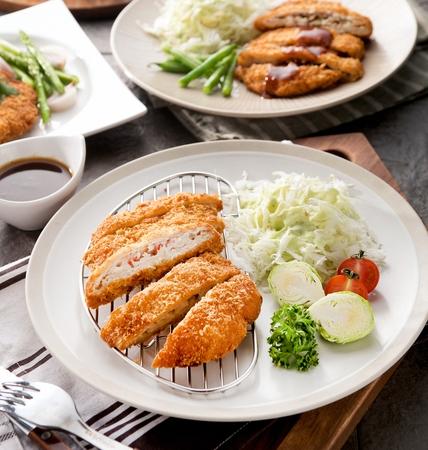 Donkatsu, pork cutlet served with lettuce salad