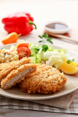 Donkatsu, pork cutlet served with lettuce salad