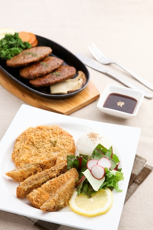 Donkatsu, pork cutlet served with lettuce salad and rice