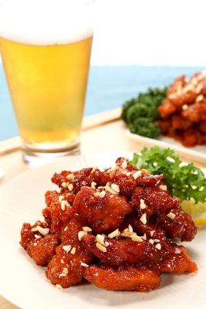 Korean Yangnyeom Chicken, seasoned spicy chicken with glass of beer