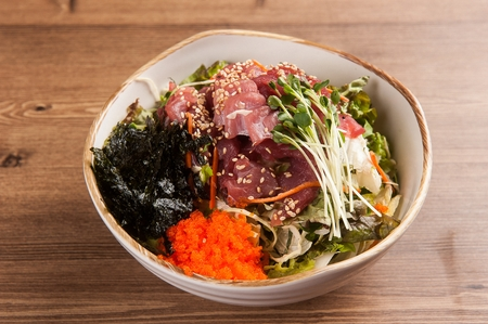 Korean cuisine Hoe-deopbap, raw fish Bibimbap mixed rice with vegetables on wood table