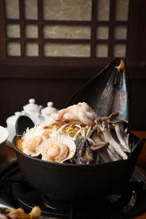 Korean cuisine Haemul-tang, spicy seafood stew with scallop, octopus, abalone and mushroom  in pot