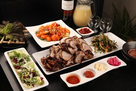 Jokbal, steamed pork feat served with chives salad and lettuce salad