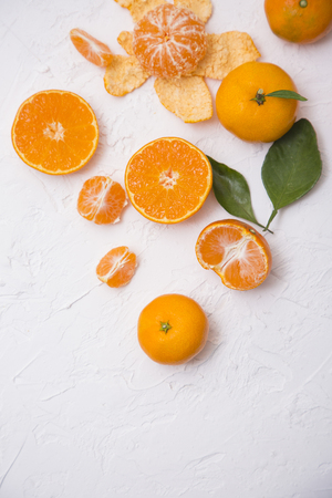Collections of fresh tangerines. Tangerine slices with leaves. Fruit composition.