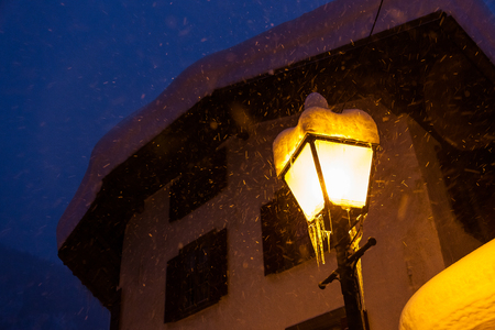 Swiss cold winter streetlights snow Stock Photo