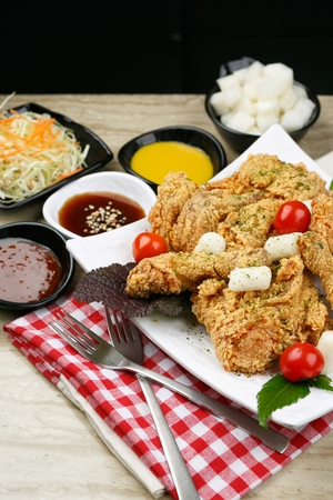 fried chicken and fried rice cake on plate Stock Photo