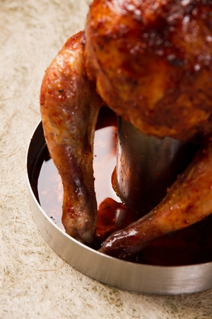 a fully roasted beer can chicken