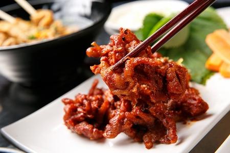 spicy chicken feet on chopsticks