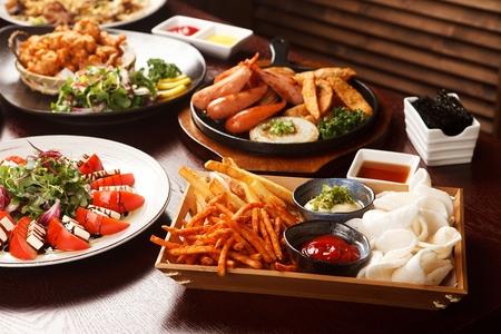french fries, chips, caprese salad, chicken fillet and salad Standard-Bild - 119985618