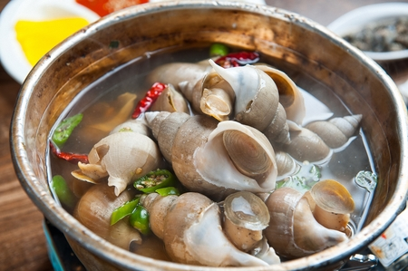 whelk soup in stainless bowl Stock Photo