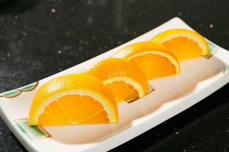 orange sliced in quarters