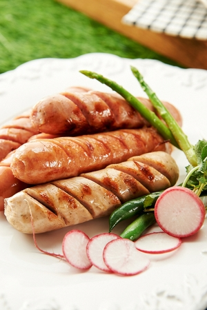 grilled sausages with small cuts on surface Stockfoto