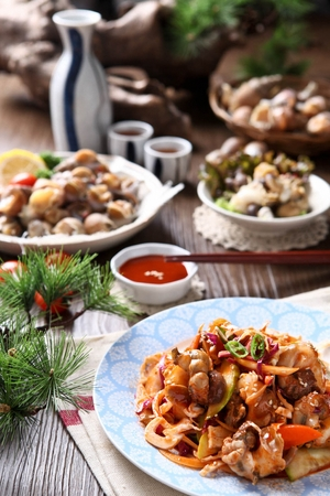 spicy seasoned whelk with vegetables Stock Photo