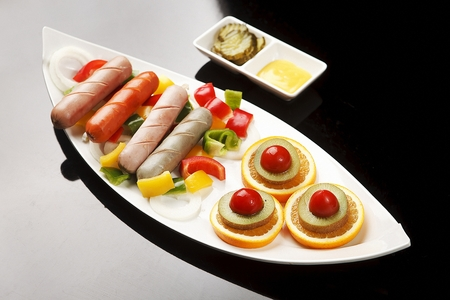sausages and fruits including orange and kiwi