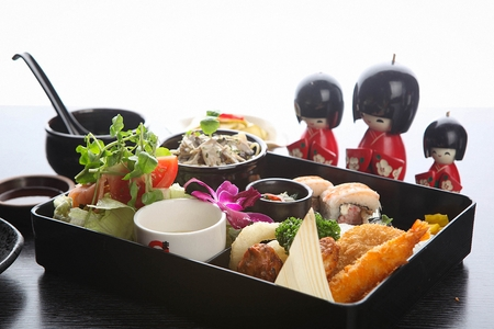 Japanese style lunchbox with fried shrimp, croquette, shrimp roll and cabbage salad