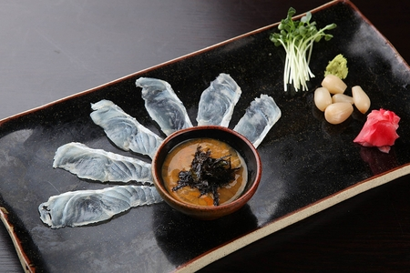 thinly sliced fish sashimi and dipping soy bean sauce with seaweeds 스톡 콘텐츠