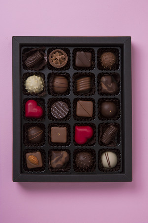 Sweet love, Valentine's day. Heart shaped candy, chocolate, macaroons and rose. Stok Fotoğraf - 122610157