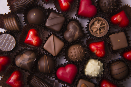 Sweet love, Valentines day. Heart shaped candy, chocolate, macaroons and rose.