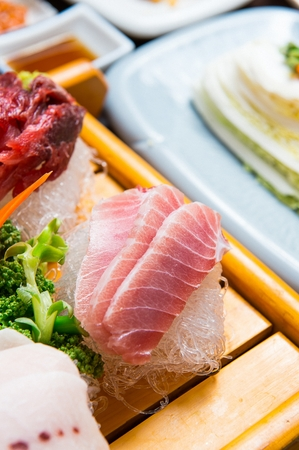 close-up shot of tuna sashimi platter in wood plate
