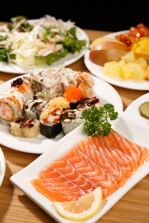assorted sushi and salmon sashimi