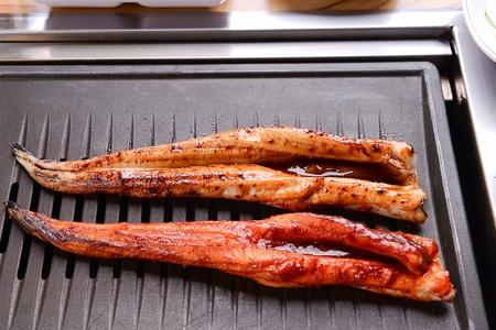 spicy seasoned eel being grilled