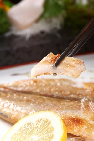 grilled sea bream on chopsticks Standard-Bild