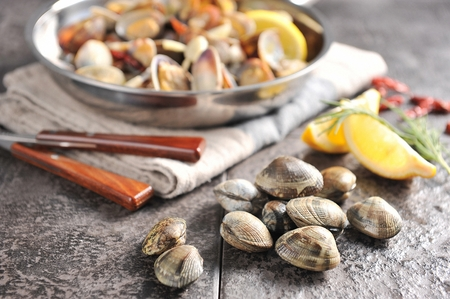 steamed manila clam on pan, manila clam and salt on table