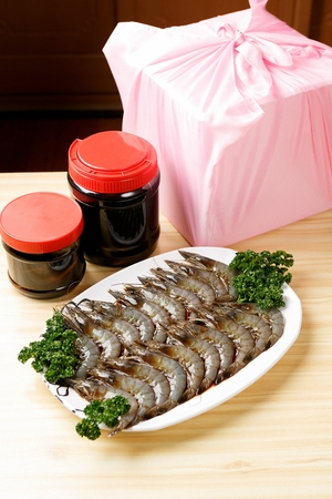 raw shrimps marinated in soy sauce