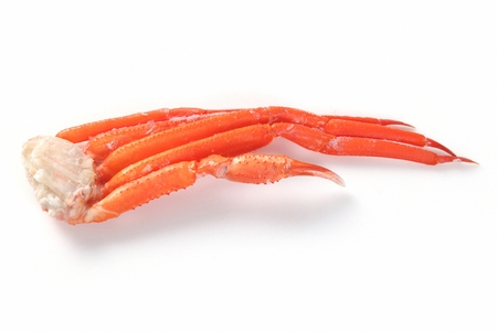 steamed king crab legs, white background