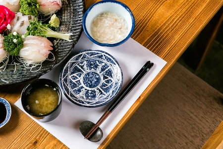 fish sashimi served with soup and rice