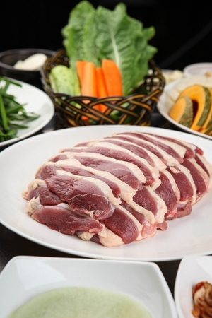 raw duck meat, radish wrapper, kimchi and side dish Stock Photo