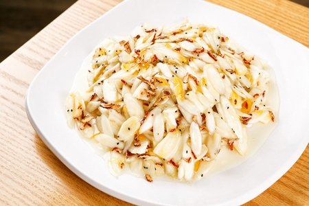 Balloon flower root salad with sprinkled citron sauce and dried jujube on plate
