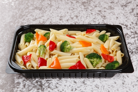 penne pasta in black disposable container