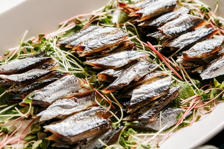 Billfish on plate with various vegetables such as perilla leaves Stock Photo