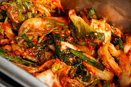 Spicy marinated cabbage kimchi on plate