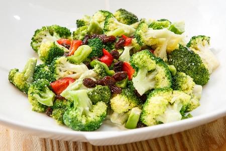 Broccoli salad with raisins on plate