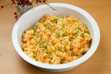 Stir-fried rice with minced carrots and egg, on plate 版權商用圖片
