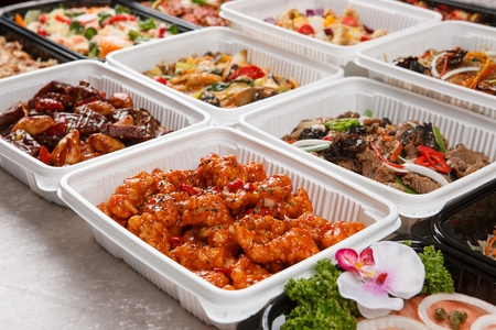Various marinated fried chicken in plastic boxes