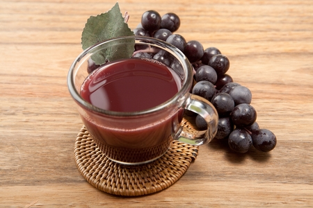 fresh grape juice and bunch of grape