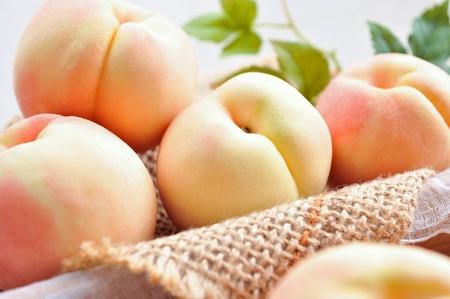 peaches on woven fabrics Banco de Imagens