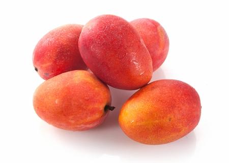 Five apple mangoes, in white background 免版税图像