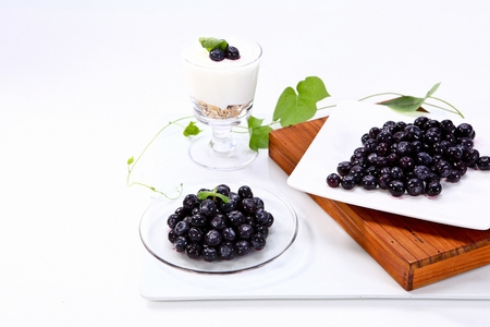 blueberries on plates and blueberry yoghurt