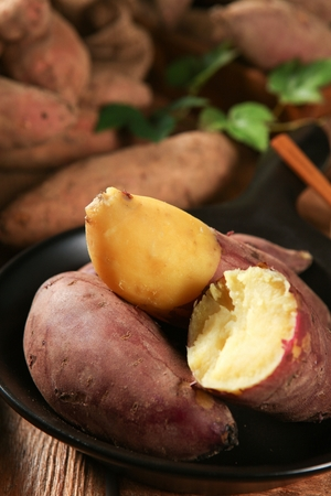 grilled sweet potatoes in round black bowl