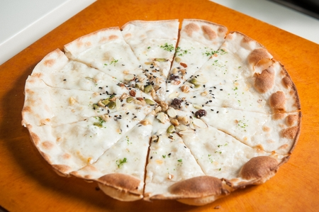Gorgonzola pizza with miced peanuts and chocolates