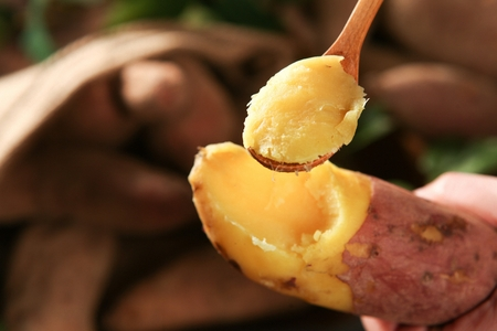 scooping sweet potato using spoon Stock Photo