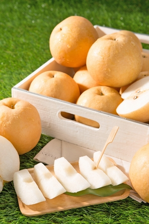 pears in square wood tray